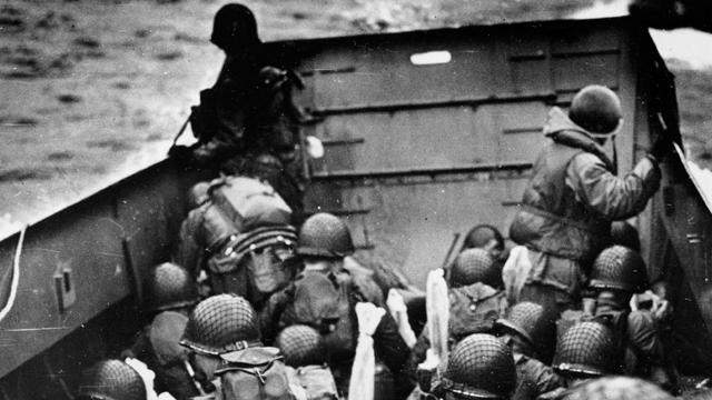 American soldiers approaching the beaches of Normandy on June 6, 1944.