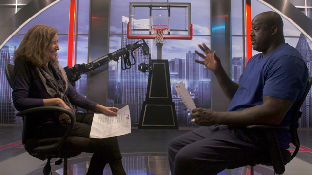 Host Lisa New with former NBA player Shaquille O'Neal