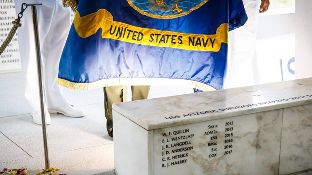 The USS Arizona Memorial wall with the names of the fallen soldiers inscribed on it.
