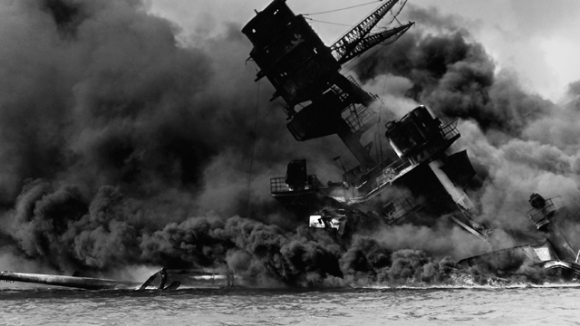The USS Arizona burning after the Japanese attack on Pearl Harbor on December 7, 1941.
