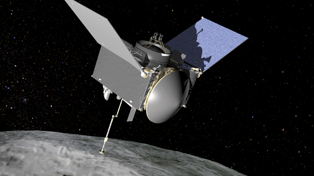 OSIRIS-REx extends its sampling arm as it moves in to make contact with the asteroid Bennu