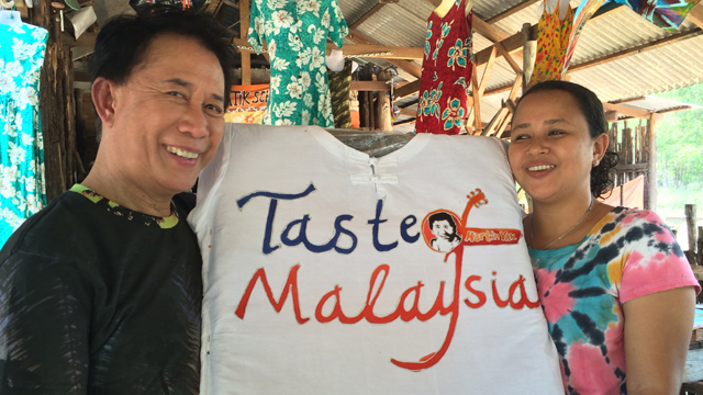 Host and chef Martin Yan has a lesson in batik painting.