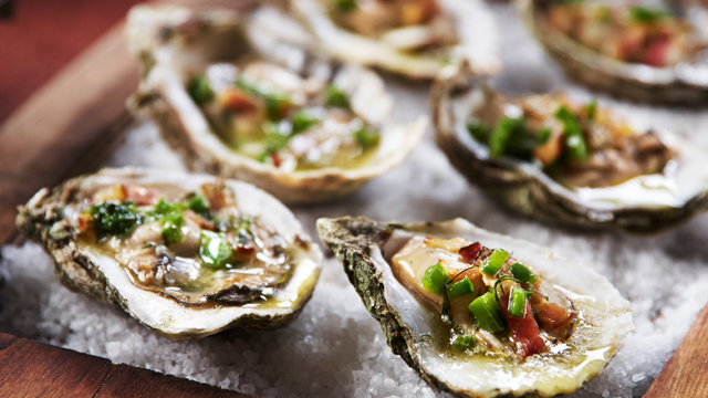 Smoke-roasted Florida oysters and clams. Photo credit Chris Bierlein.